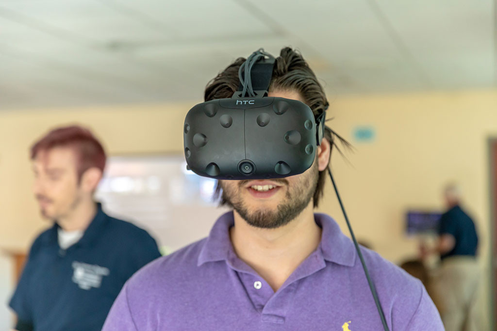 Student wearing VR headset.