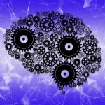 Illustration of cogs and gears in the shape of a brain.
